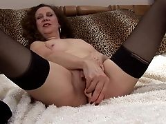 Curly-haired Granny With A Dirty Mind Using The Realistic Fuck Stick