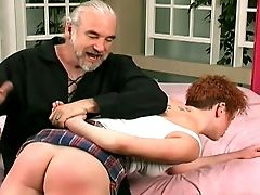 Old Fart Hits This Redhead's Jummy Butt With A Spanking Paddle For Her Bad Behavior